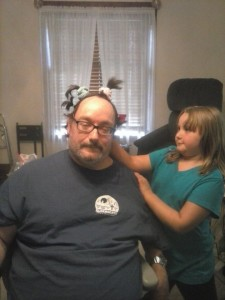 Photo of daughter playing with her father's hair