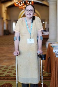 Image of white woman standing with crutches