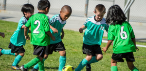 Photo of young children playing soccer