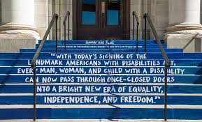 Stairs painted with quote by President George H.W. Bush: With today's signing of the landmark Americans for Disabilities Act, every man, woman, and child with a disability can now pass through once-closed doors into a bright new era of equality, independence, and freedom.