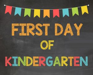 Image says first day of kindergarten. Above are colorful flags