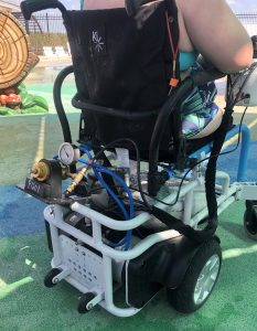 Color photograph of the back of the air powered waterproof wheelchair showing the tanks of air underneath the seat.